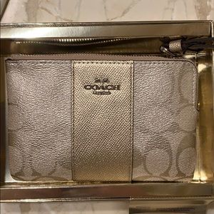 NWT Signature Coach Gold Zip Wristlet.